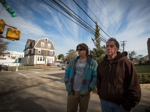 <p>Paul Wade (R), 53, and his son Kyle, said the pub was the heart of the neighborhood.</p>