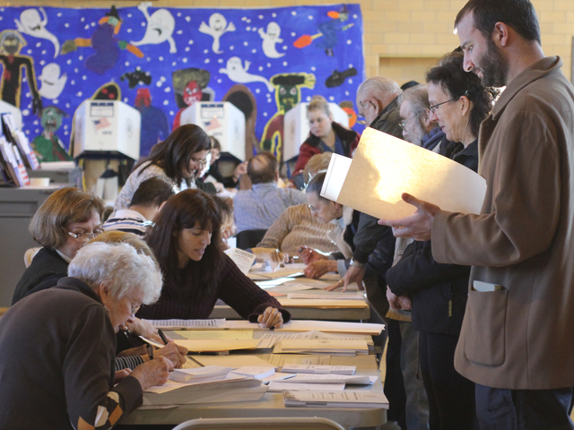 <p>Poll workers at help direct a voter at P.S. 184 in Whitestone on Nov. 6.</p>