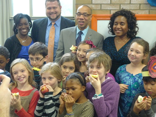 <p>Schools Chancellor Dennis Walcott, center, poses with P.S. 10 students and staff during the Big Apple Crunch.</p>