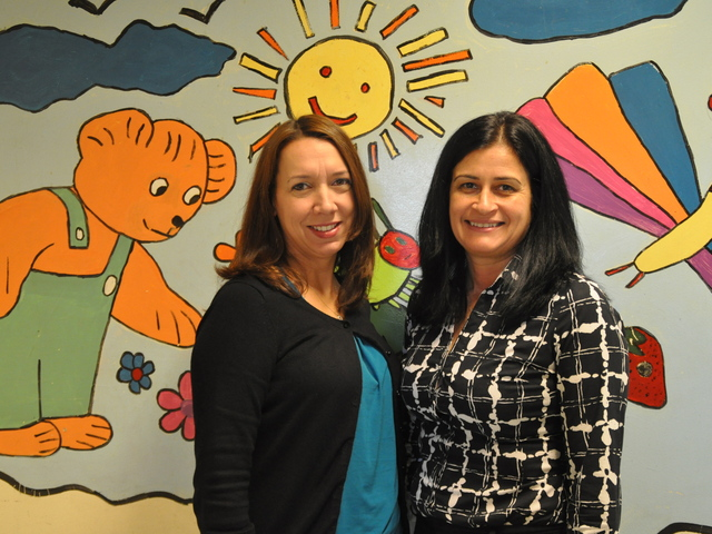 <p>P.S. 132&#39;s principal Beth Lubeck and parent coordinator Yvonne Garguilo&nbsp;welcomed back students Monday after one week of no school due to Hurricane Sandy.</p>