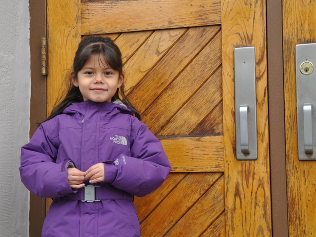<p>Madison Murray, 6, prepared to enter the door of P.S. 132 for her first grade class after one week without school.</p>