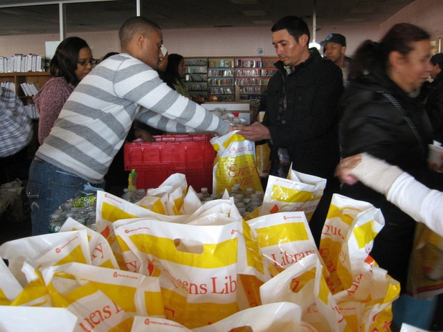 <p>Queens Library opened to provide emergency supplies to the community. It also distributed food at Far Rockaway.</p>