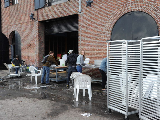 <p>Red Hook residents clean up after Hurricane Sandy.</p>
