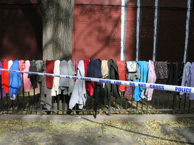 <p>Donates clothes hung outside the Fulton Houses.</p>