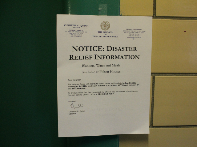 <p>A sign posted in Fulton announcing a food distribution on Sunday, Nov. 4, 2012.</p>
