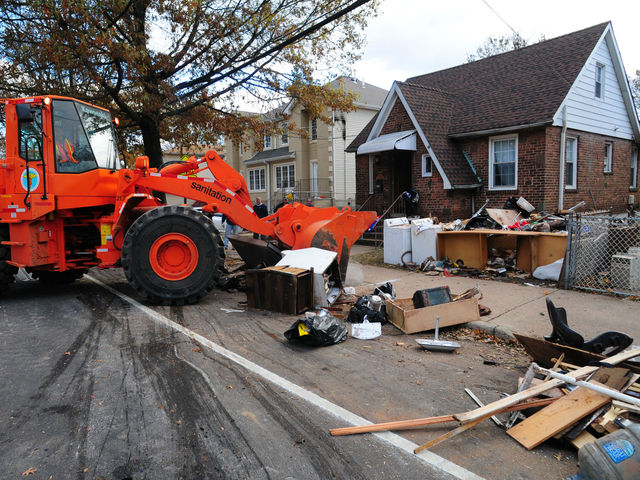 <p>Sanitation crews cleaned up the wreckage left by Hurricane Sandy in Staten Island on Sunday. The Department of Sanitation will end their storm debris collection on January 14, 2013.</p>