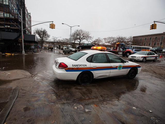 <p>Sanitation officers patrol Rockaway Beach on Nov. 7, 2012.</p>