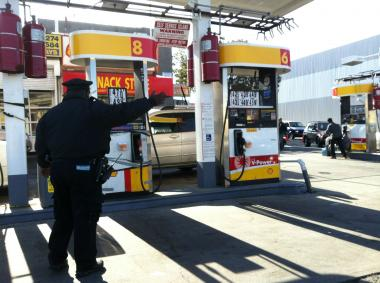Lines at stations stretched for blocks Friday, Nov. 9, 2012, as gas rationing went into effect.
