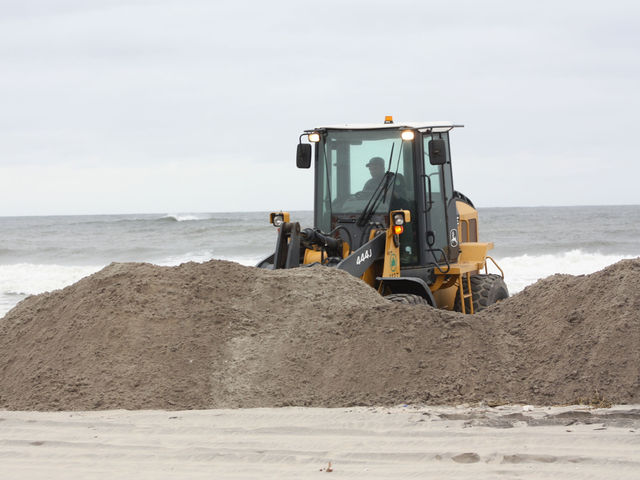 <p>Crews worked to reinforce the beachfront at the Rockaways in preparation for Hurricane Sandy, Oct. 28, 2012.</p>