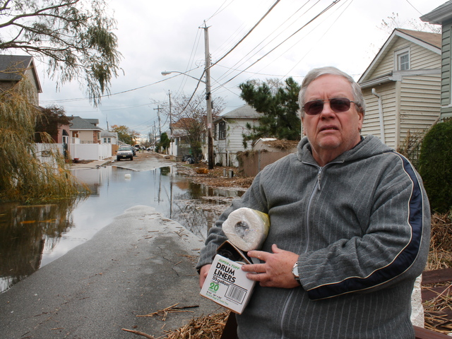 <p>October 31, 2012 - A local man helped his family with supplies on Fox Beach Lane Wednesday.</p>