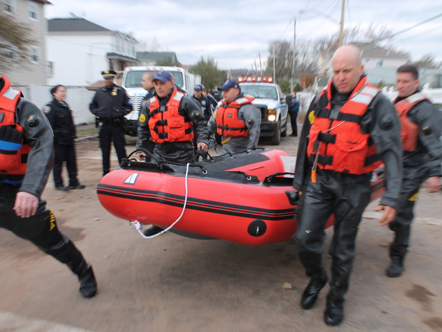 <p>October 31, 2012 - The NYPD use a plastic raft to look for anyone trapped in their home on Arthur Avenue.</p>