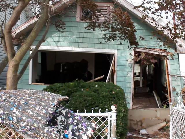 <p>November 1, 2012 - A house on Cedar Grove Avenue lost its garage door and front door in the hurricane, leaving what&#39;s left inside vulnerable to looters.</p>