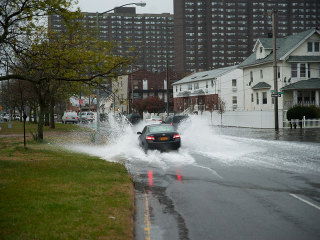 <p>Cars navigate flood waters on Seagirt Boulevard at Beach 28th Street in Far Rockaway on Monday October 29th, 2012.</p>