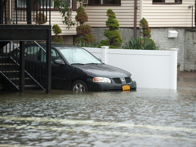 <p>A car in flood waters on Beach 29th Street in Far Rockaway on Monday October 29th, 2012.</p>
