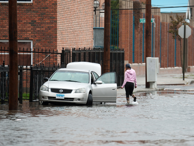 <p>A resident prepares to load up her car on Beach 29th Street in Far Rockaway on Monday October 29th, 2012.</p>