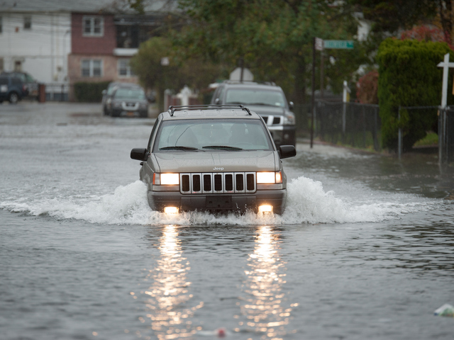 <p>A car in flood waters on Seagirt Boulevard in Far Rockaway on Monday October 29th, 2012.</p>