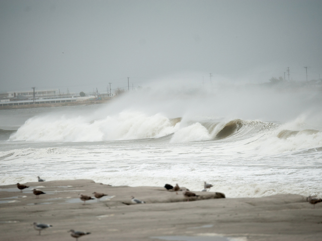 <p>High surf crashes ashore near Beach 34th Street in Far Rockaway on Monday October 29th, 2012.</p>