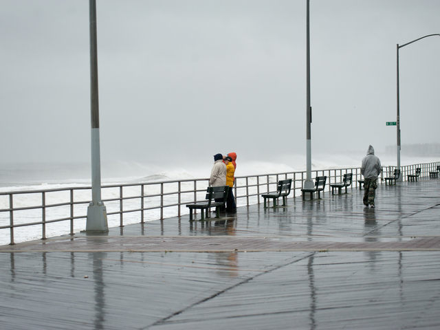 <p>People came out on the boardwalk to watch the powerful surf near Beach 36th Street in Far Rockaway on Monday October 29th, 2012.</p>