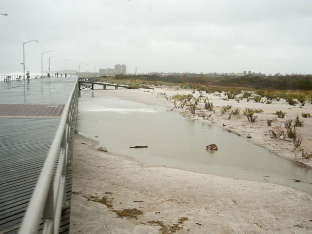 <p>Sea water goes past the boardwalk near Beach 34th Street in Far Rockaway on Monday October 29th, 2012.</p>