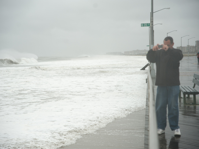 <p>High surf crashes ashore and rushes past the boardwalk near Beach 36th Street in Far Rockaway on Monday October 29th, 2012.</p>
