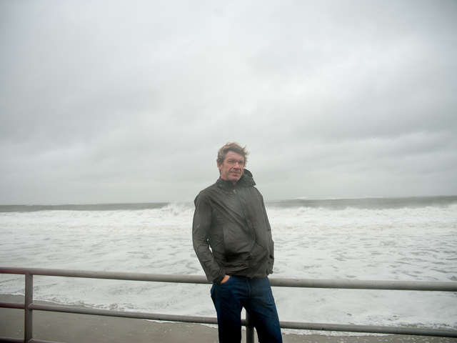 <p>Resident Giles Ashford came to take photos of the surf near Beach 34th Street in Far Rockaway on Monday October 29th, 2012. Giles insisted he was staying put &quot;I really am not in fear of anything happening, I have been through worse&quot; said Giles.</p>