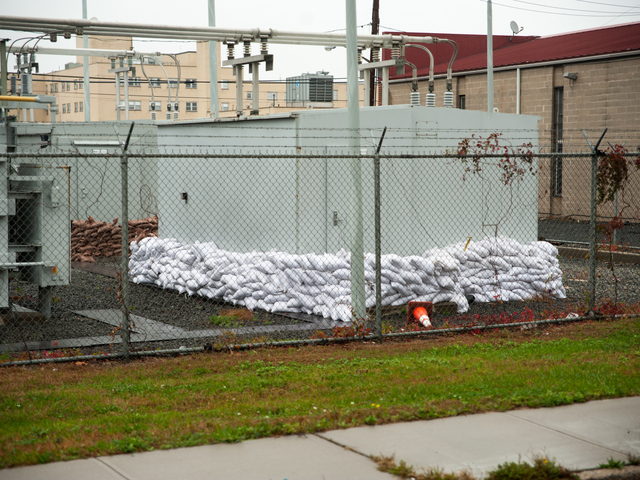 <p>A power facility in Far Rockaway is protected by sandbags on Monday October 29th, 2012.</p>