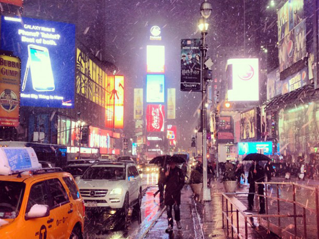 <p>Snow hits Times Square in November 2012.</p>