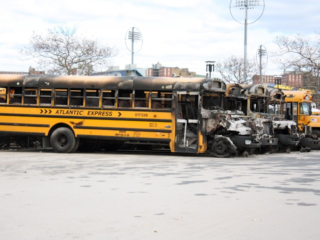 <p>School buses in a depot in Coney Island were torched after Hurricane Sandy.</p>
