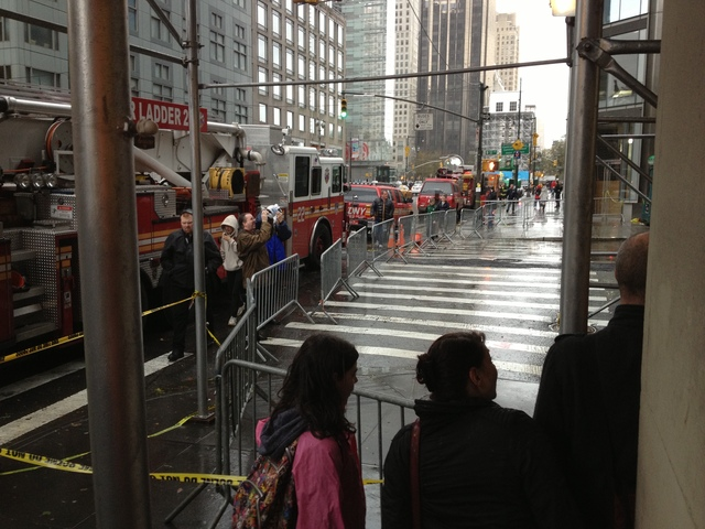 <p>Tourists visited 57th Street Tuesday Oct. 30, 2012, to see a crane that collapsed and was in danger of falling.&nbsp;</p>
