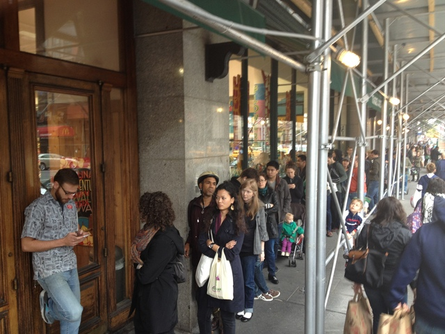 <p>The line at the Trade Joe&#39;s in Chelsea stretched around the block on Sunday as people waited to stock up on supplies.</p>