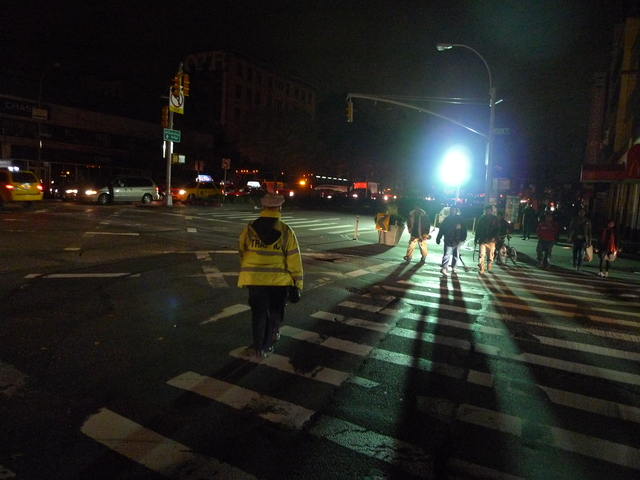 <p>A traffic cop and NYPD spotlight at Delancey and Essex after Hurricane Sandy knocked out power.</p>