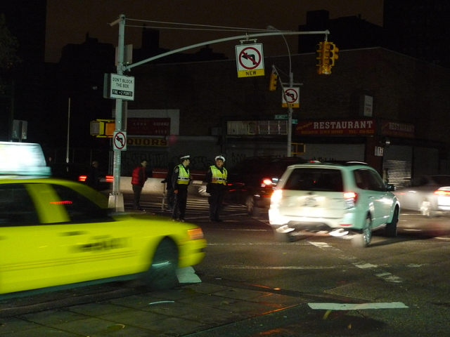 <p>Cops do what they can to direct traffic at Delancey and Essex on the Lower East Side after Hurricane Sandy knocked out power in lower Manhattan.</p>