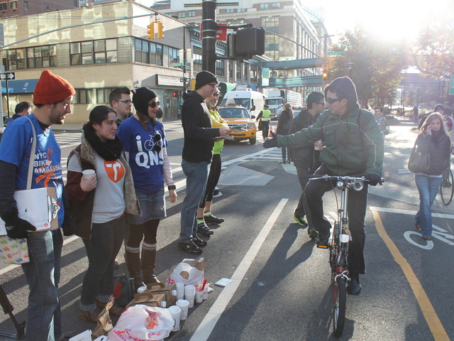 <p>Transportation Alternatives was giving out free coffee and donuts to cyclists and pedestrians at the entrance to the Queensboro Bridge on November 1, 2012.</p>