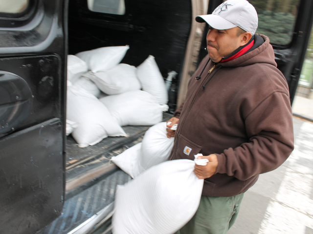<p>Ulises Vergara, 30, delivers sandbags to a business at the corner of Richards and Wolcott streets in Red Hook ahead of Hurricane Sandy Sunday, Oct. 28, 2012.</p>