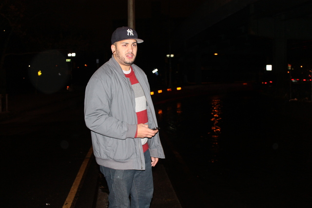 <p>Jon Candelaria, 25, stands near FDR Drive where he rescued a stranded taxi driver who was about to drown from chest deep water during the height of Hurricane Sandy on Monday.</p>