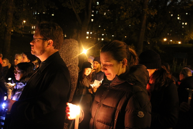 <p>A woman overcome by emotion at the vigil at Hippo Park for six-year-old Lucia&nbsp; and 2-year-old Leo Krim, who were allegedly stabbed and killed by their nanny in their Upper West Side home, Oct. 26, 2012.</p>
