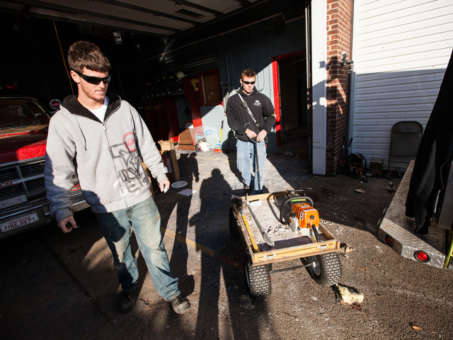 <p>Volunteer firefighters clear debris at the Rockaway Point Fire Station on Nov. 5th, 2012.</p>