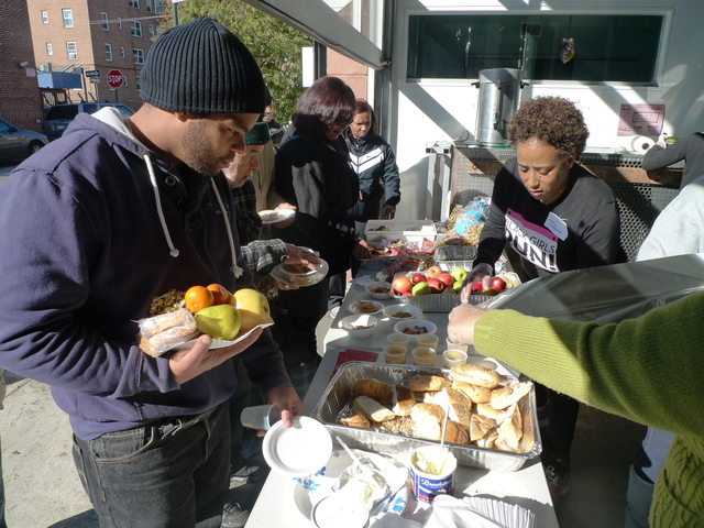 <p>Volunteers hand out meals at Red Hook Initiative following Hurricane Sandy. The local nonprofit has also been delivering meals to homebound residents affected by the hurricane.</p>