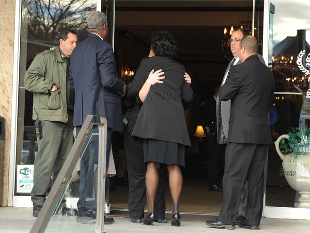 <p>Mourners embrace at the Thursday, Nov. 8, 2012, wake for Brendan and Connor Moore, 2 and 4, who drowned during Hurricane Sandy.</p>