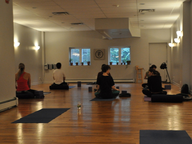 <p>Students settled on their mats in Abhyasa Yoga Studio.</p>