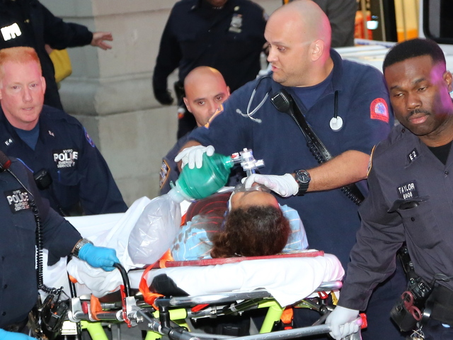 <p>Nanny Yoselyn Ortega, her shirt bloody from an apparently self-inflicted throat wound, is wheeled away by medics at 57 W. 75th Street, after she allegedly stabbed to death 2-year-old Leo Krim and 6 year-old Lucia Krim, known as Lulu.</p>