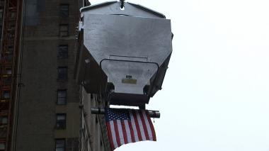 10-ton bucket of concrete, American flag attached, soars to the top of the Beekman Tower in downtown Manhattan.