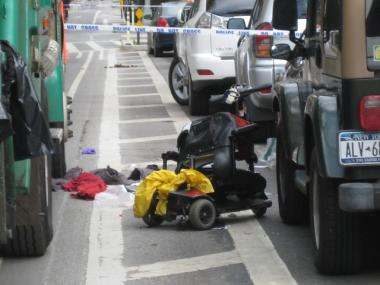 The wreckage of Shami Chaikin's motorized wheelchair after she swerved to avoid a sanitation truck parked in a bike lane on Eighth Avenue.
