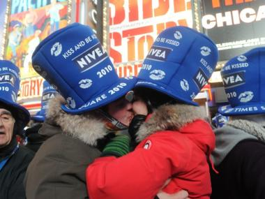 Italian husband and wife Elizabeth and Claudio D'Addato kiss in Times Square.