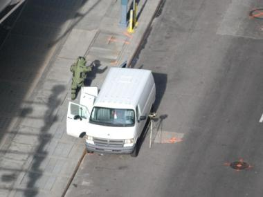 A bomb squad worker gives a thumbs up next to a suspicious van in Times Square.