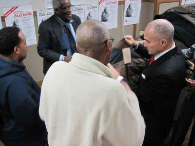 NYPD Commissioner Raymond Kelly helps Bowery Mission resident Nathaniel Smith find a new coat, Dec. 1, 2009.