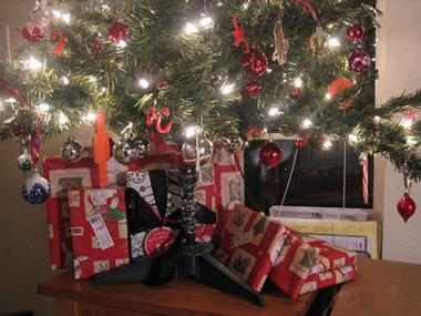 Wrapped gifts wait under the Christmas tree.