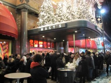 Shoppers crowded outside of Macy's in Herald Square when it was evacuated for an escalator fire on Sunday.