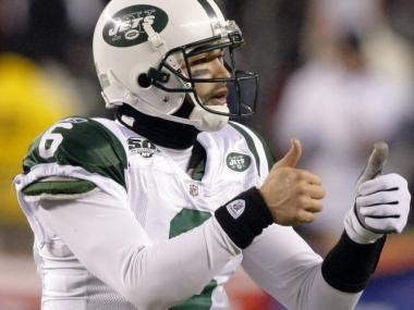 Rookie quarterback Mark Sanchez gives the thumbs up during a game. The team announced reduced season ticket prices on Friday, June 11, 2010.