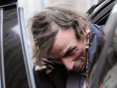 Joseph Brooks leaving Manhattan Supreme Court on Jan. 19, after a judge scheduled a new bail hearing for the disgraced composer. (Josh Williams/DNAinfo)